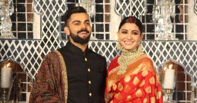 Virat Kohli and Anushka Sharma celebrate India's big Win